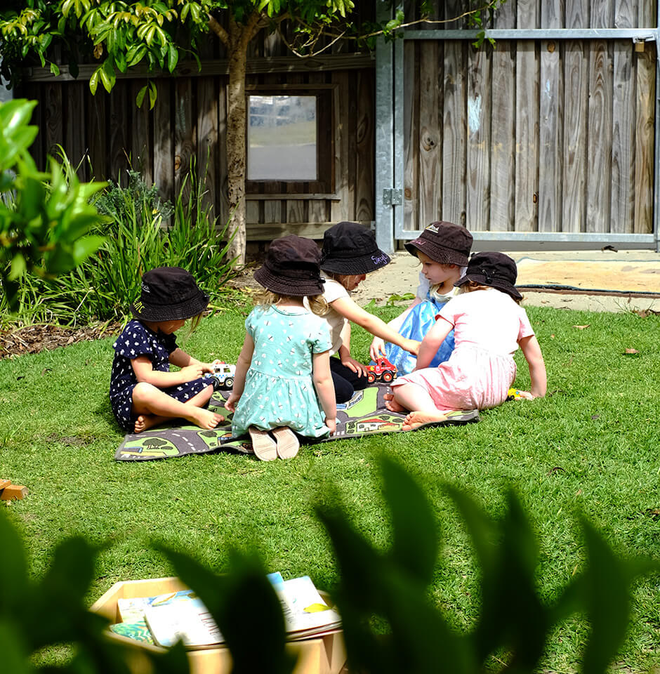 The Brook Early Education and Care - Girls playing on the lawn
