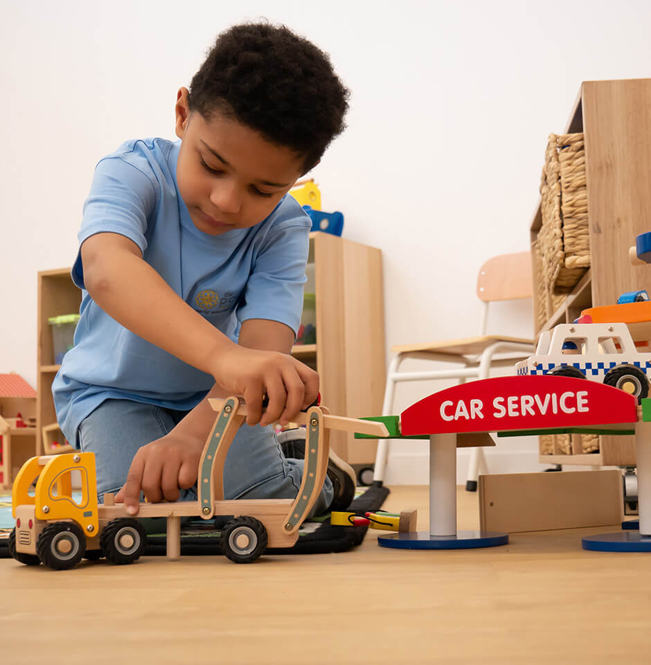 The Pocket Early Education and Care - Philosophy - Boy Playing with Truck