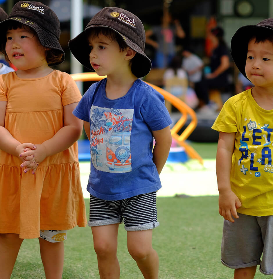 The Pocket Early Education and Care - Group multi-ethnic children playing outdoors