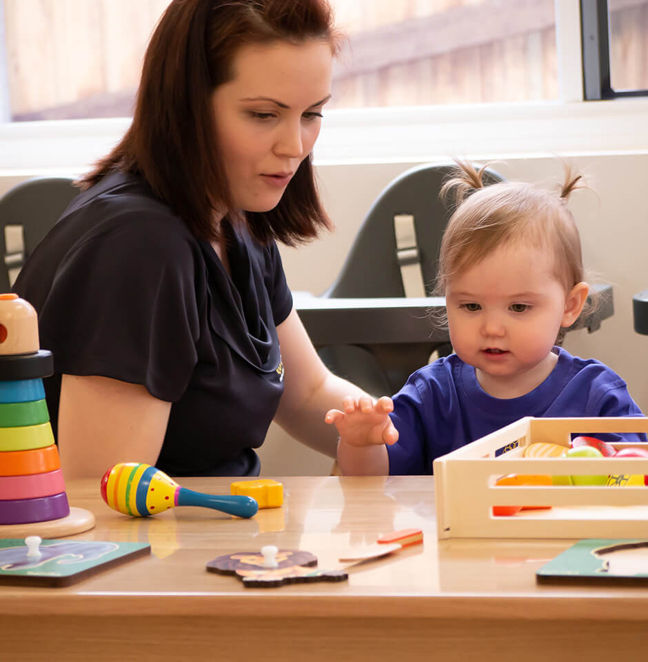 The Brook Early Education and Care - Devoted Educator playing with toddler