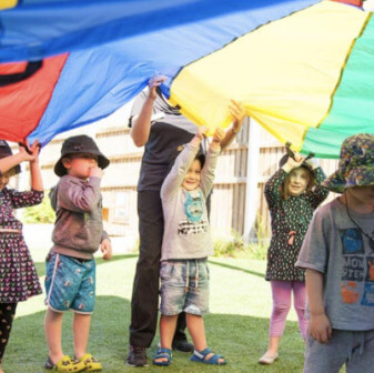 The Brook Early Education and Care - Group of Children Execising outdoors
