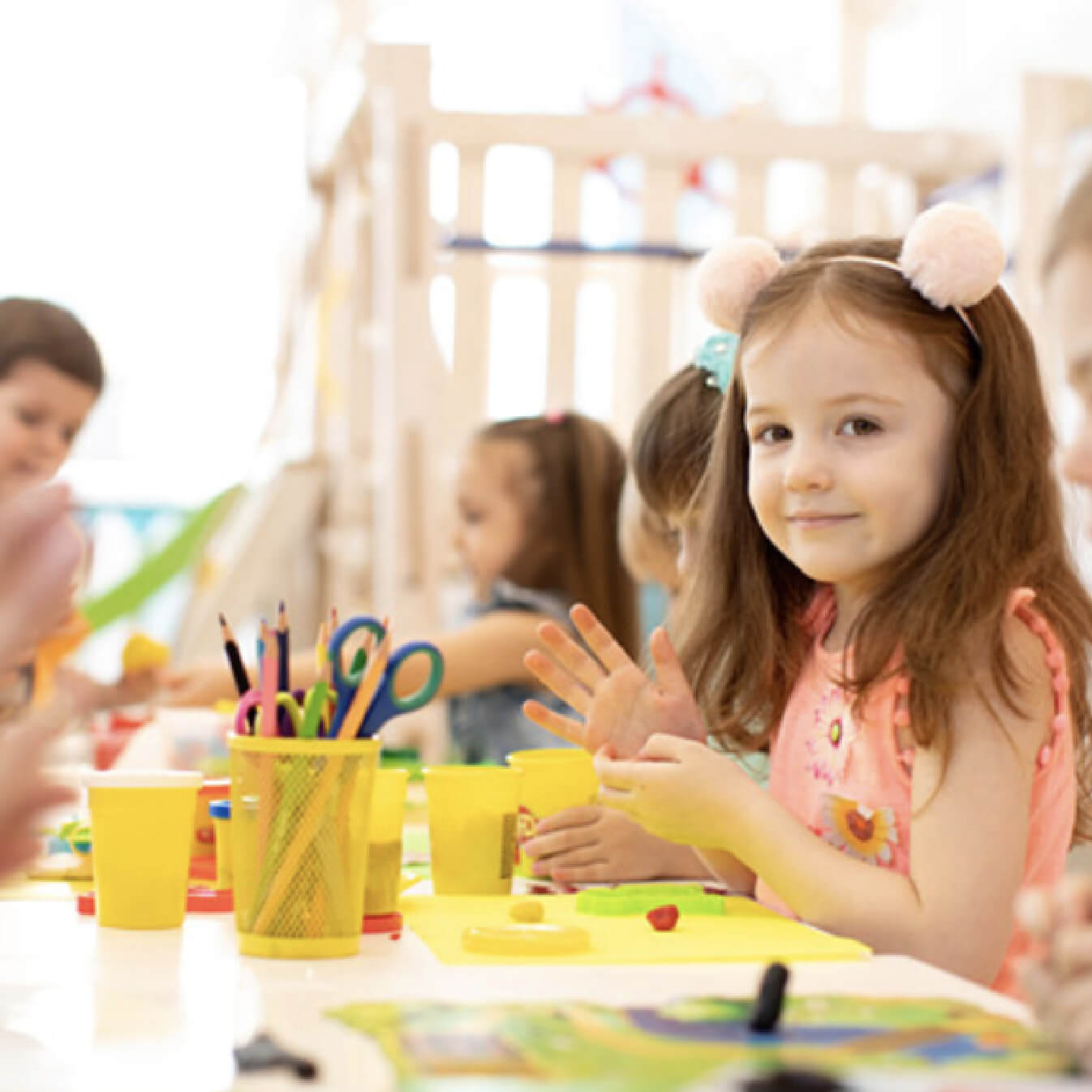 The Pocket Early Education and Care - Kindy aged female play with Playdoh