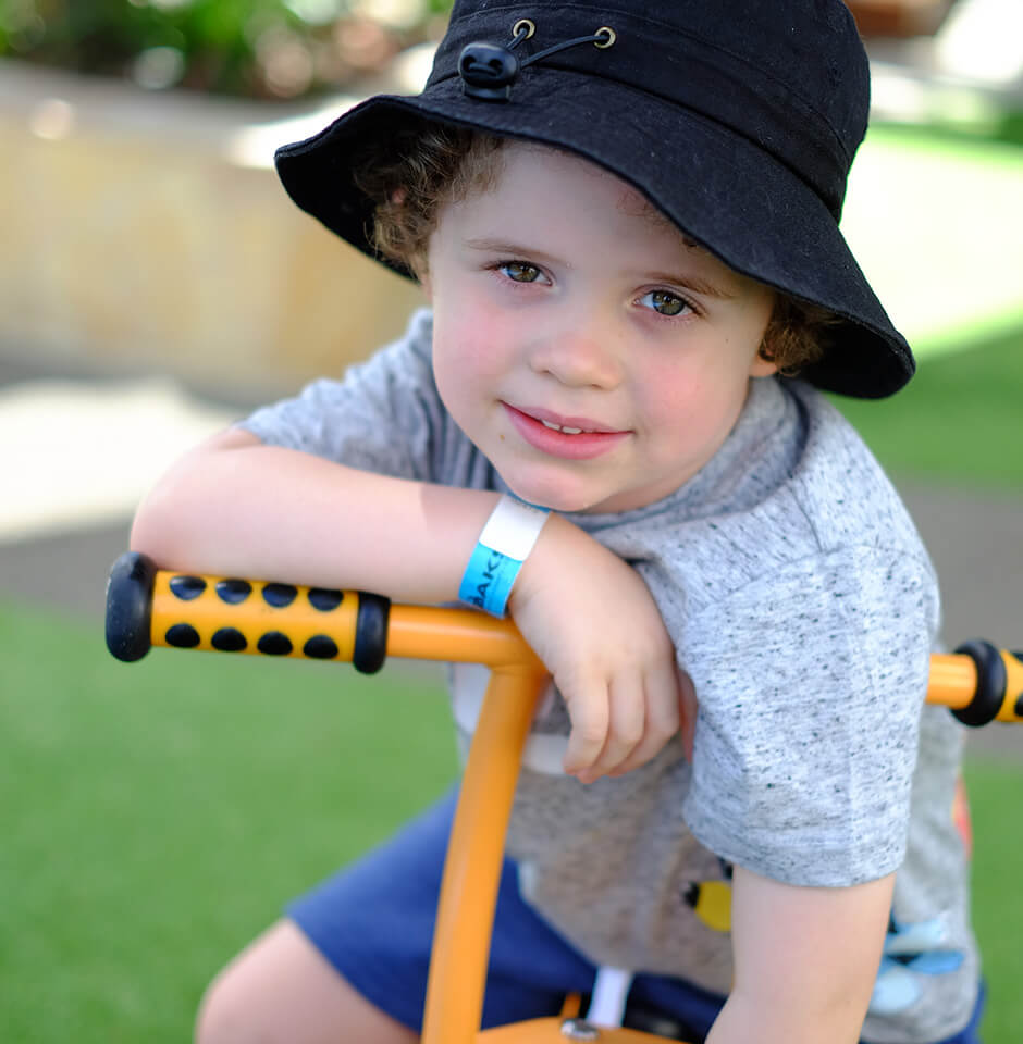 The Brook Early Education and Care - Preschooler riding a bike