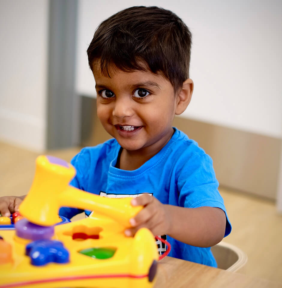 The Brook Early Education and Care - Learning Through Play - Boy Hammering