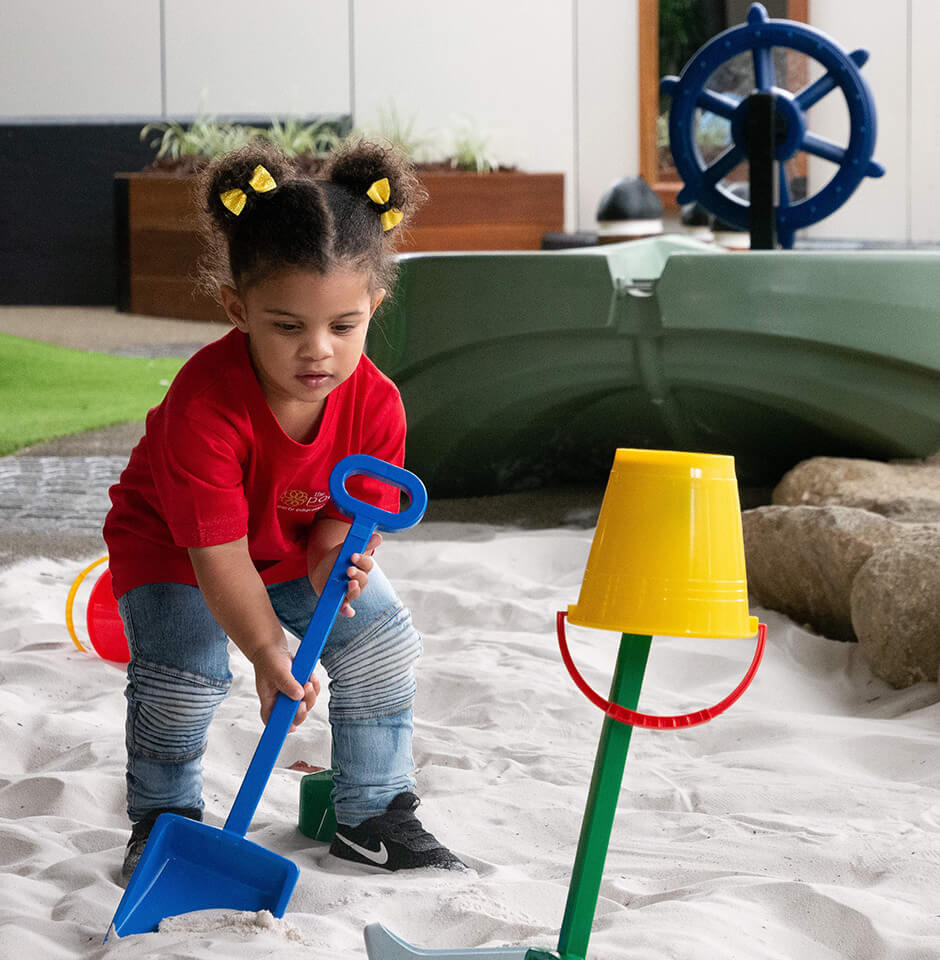 The Pocket Early Education and Care - Learning Through Play - Girl playing in sandpit